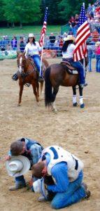 Cowboys pray before the event
