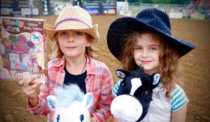 Julia Cooke, Stick Horse Champion, and sidekick Ella Fowers