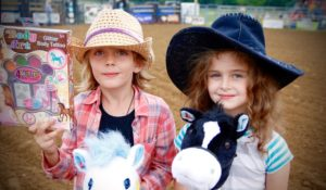 Julia Cooke, Stick Horse Champion, and sidekick Ella Fowers